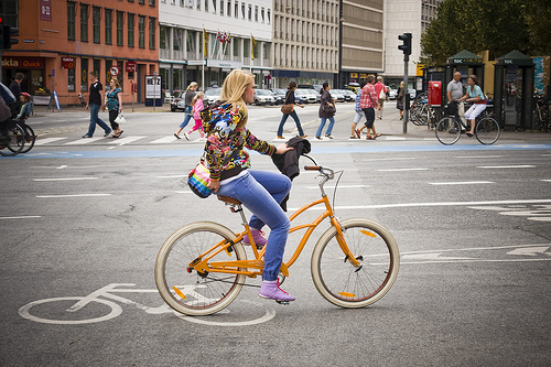 chick on yellow bike